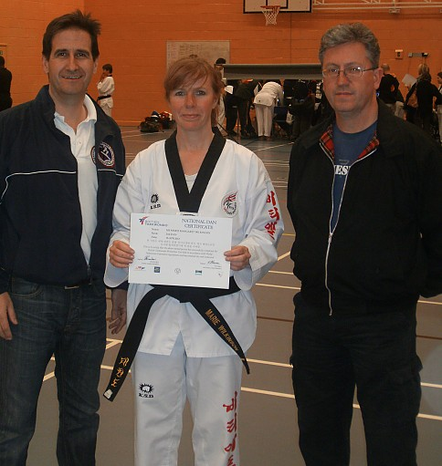 2012_-_Marie_Wilkinson_promoted_to_2nd_Dan_with_Instructors_Kevin_George__Con_Halpin